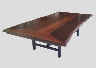 Large outdoor table with four natural edges on a slim frame