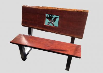 Buddy bench with school emblem in glass leadlight panel