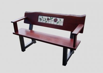 Bench seat with red roses glass panel and natural edge backrest and armrests