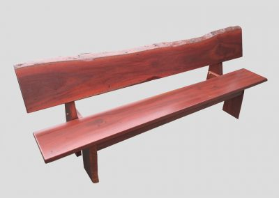 Long bench with natural edge backrest and timber legs