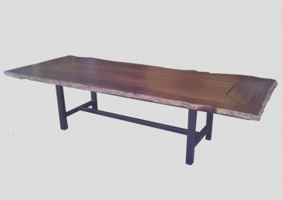 Jarrah table with natural edges and legs inset from table edges